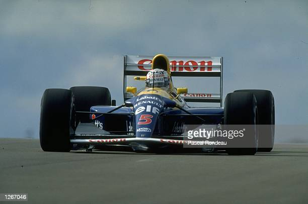 Nigel Mansell of Great Britain in action in his Williams Renault during the British Grand Prix at the Silverstone circuit in England Mansell finished...