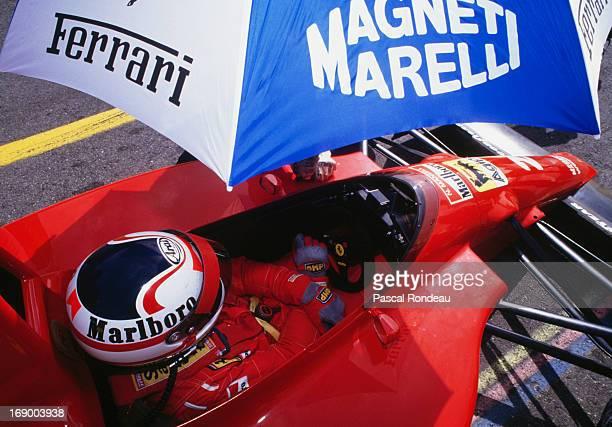Nigel Mansell of Great Britain sits aboard the Scuderia Ferrari Marlboro Ferrari 641 Ferrari V12 during during pre season testing on 1st February...