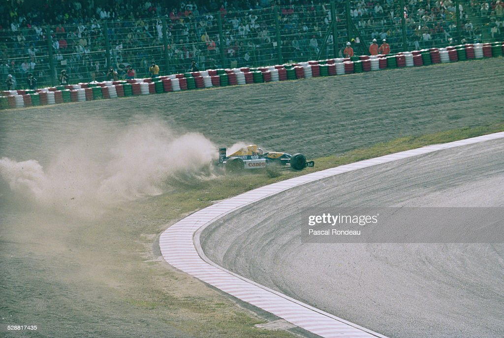 Nigel Mansell of Great Britain spins into the gravel trap on lap 9 driving the Canon Williams Renault Williams FW14 Renault RS3 V10 during the Fuji...