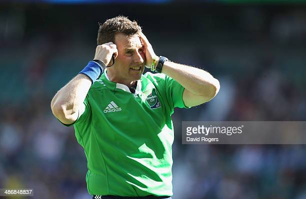 Nigel Owens the referee award the TMO decision before awarding a try to Owen Farrell of Saracens during the Heineken Cup semi final match between...
