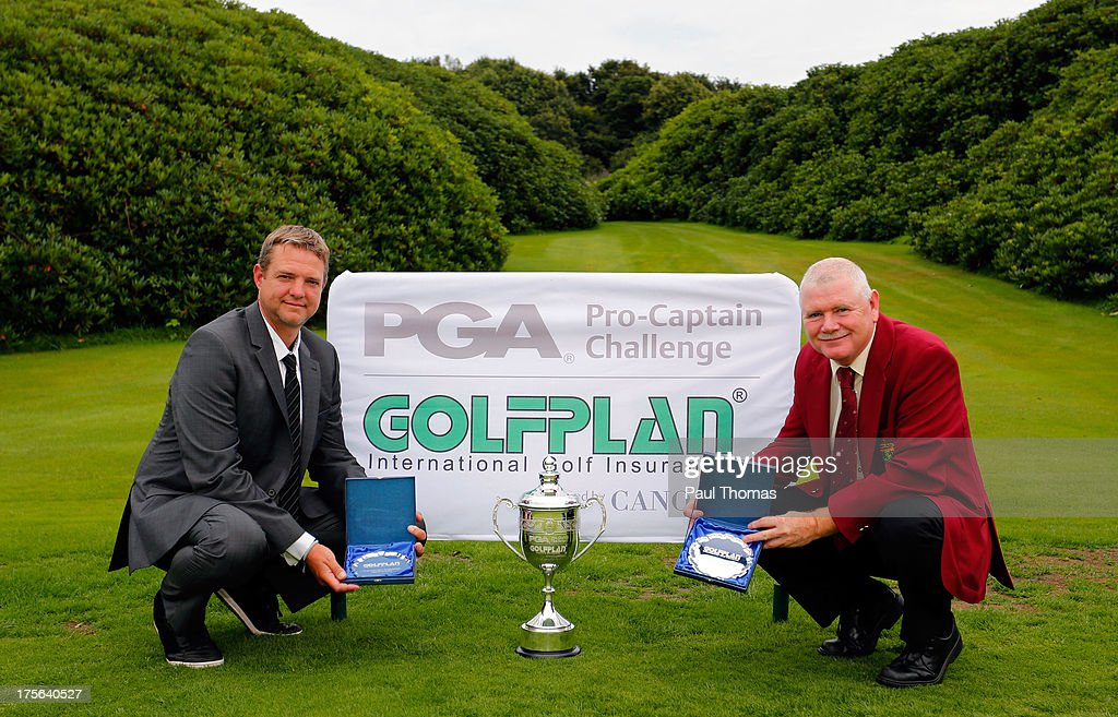 Nigel Parkinson (L) and David Briggs of Renishaw Park Golf Club pose for a photograph after winning The Golfplan Insurance Pro Captain Challenge Regional Qualifier at Huddersfield Golf Club on August 5, 2013 in Huddersfield, England.