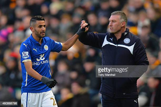 Nigel Pearson manager of Leicester City congratulates Riyad Mahrez of Leicester City on the scoring the opening goal during the Barclays Premier...
