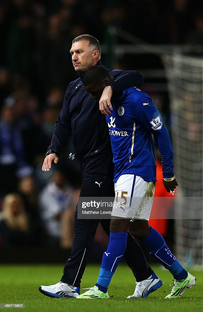 Nigel Pearson, manager of Leicester City looks dejected as he walks off the pitch with Jeffrey Schlupp of Leicester City during the Barclays Premier League match between West Ham United and Leicester City at Boleyn Ground on December 20, 2014 in London, England.