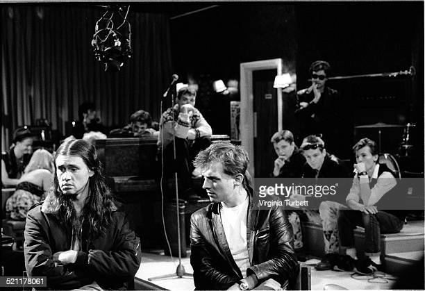 Nigel Planer as Neil and Rik Mayall as Rick with members of the band Madness behind on set during the filming of The Young Ones episode 'Boring' UK...