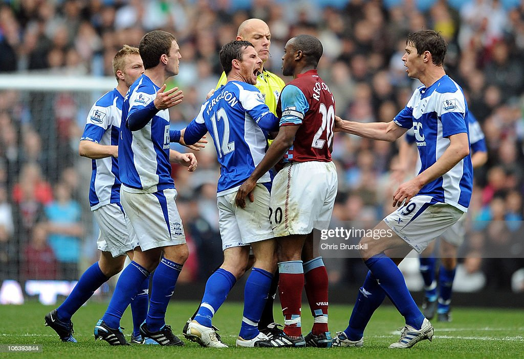 Nigel ReoCoker of Aston Villa clashes with Barry Ferguson of Birmingham City after he appeared to kick Craig Gardener during the Barclays Premier...