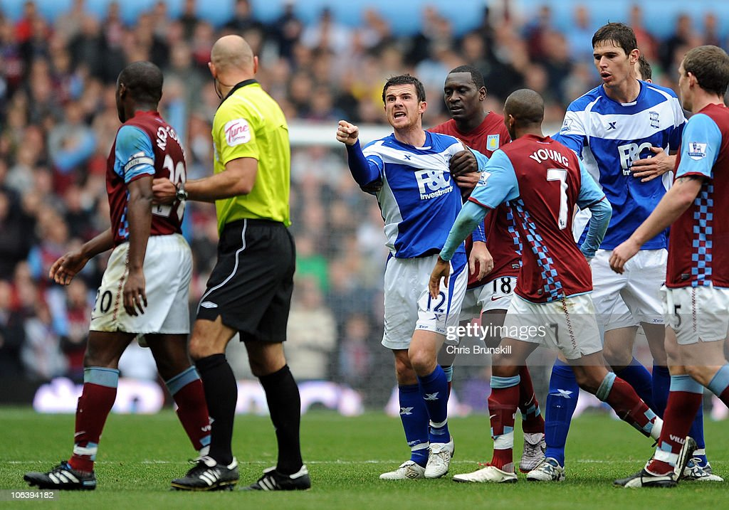 Nigel ReoCoker of Aston Villa is separated from Barry Ferguson of Birmingham City by referee Howard Webb after he appeared to kick Craig Gardener...