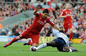 Nigel ReoCoker of Bolton tackles Luis Suarez of Liverpool during the Barclays Premier League game between Liverpool and Bolton Wanderers at Anfield...
