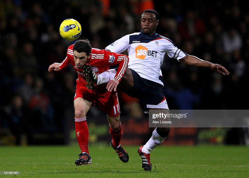 <a gi-track='captionPersonalityLinkClicked' href=/galleries/search?phrase=Nigel+Reo-Coker&family=editorial&specificpeople=214185 ng-click='$event.stopPropagation()'>Nigel Reo-Coker</a> of Bolton Wanderers challenges Maxi of Liverpool during the Barclays Premier League match between Bolton Wanderers and Liverpool at the Reebok Stadium on January 21, 2012 in Bolton, England.