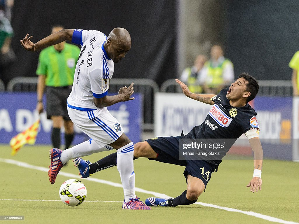 Nigel Reo-Coker #14 of the Montreal Impact trips Rubens Sambueza #14 of Club America in the 2nd Leg of the CONCACAF Champions League Final at Olympic Stadium on April 29, 2015 in Montreal, Quebec, Canada.