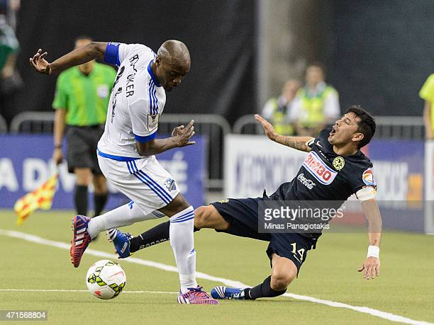 Nigel ReoCoker of the Montreal Impact trips Rubens Sambueza of Club America in the 2nd Leg of the CONCACAF Champions League Final at Olympic Stadium...