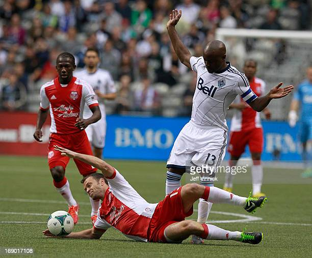 Nigel ReoCoker of the Vancouver Whitecaps FC watches as Jack Jewsbury of the Portland Timbers falls on the ball during their MLS game May 18 2013 at...