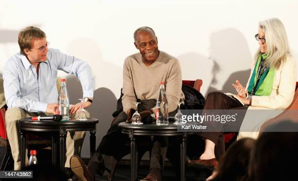 Nigel Sinclair from Exclusive Media actor Danny Glover and Joslyn Barnes from Louverture Films attend the International Film Finance Forum Presented...