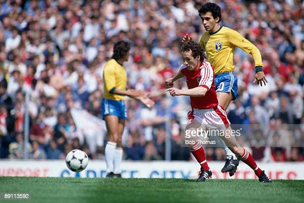 Nigel Vaughan of Wales moves away from Brazil's Pitta during the International friendly at Ninian Park in Cardiff 12th June 1983 The match ended in a...