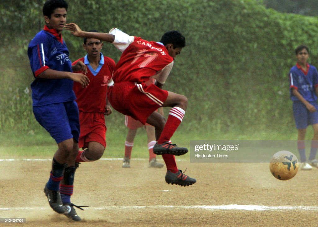 Nigel Vaz (red) of campion school and Akshay Popawala (blue) of St. Marys ICSE fighting for the ball during MSSA boys u-16 div-i-pol football match at Azad maidan on August 31, 2005.