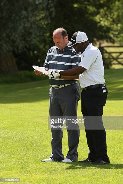 Nigel Whitton and Jimmy Gavore of Farnham Park Golf Cub check yardage at the 2nd tee during the Virgin Atlantic PGA National ProAm Championship...