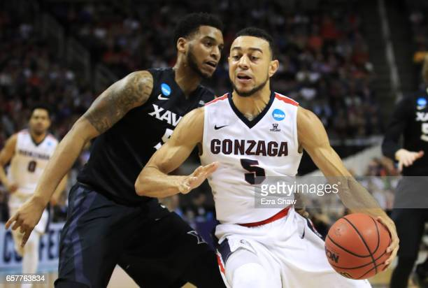 Nigel WilliamsGoss of the Gonzaga Bulldogs drives against Trevon Bluiett of the Xavier Musketeers in the first half during the 2017 NCAA Men's...