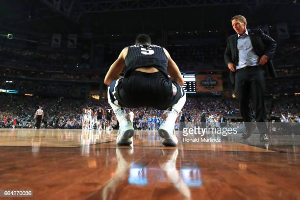 Nigel WilliamsGoss of the Gonzaga Bulldogs reacts on the court as head coach Mark Few looks on late in the second half against the North Carolina Tar...