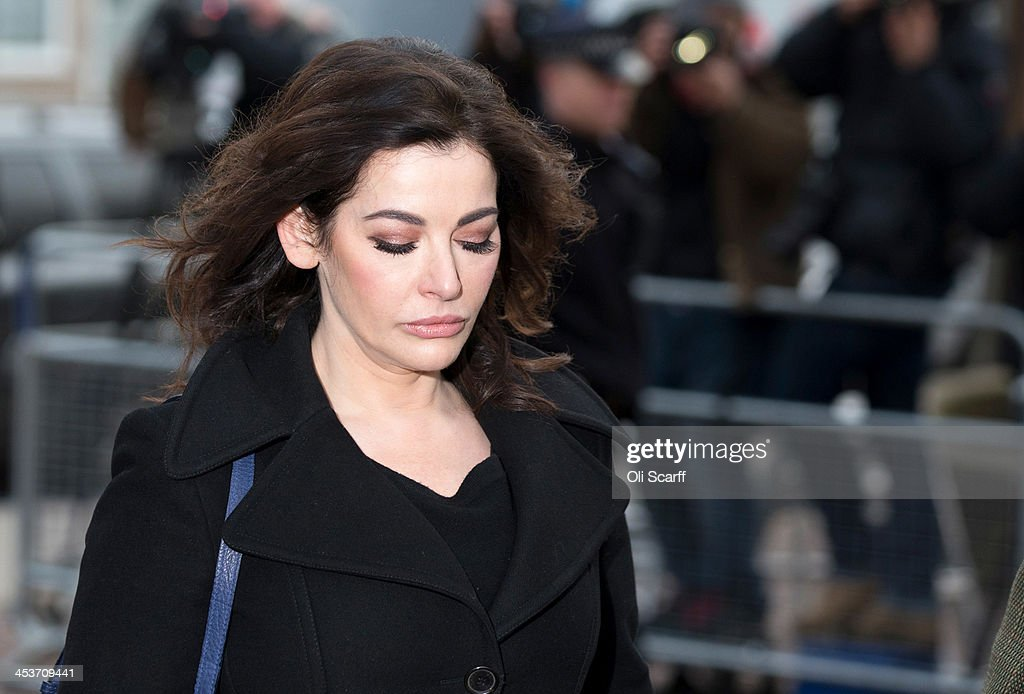 <a gi-track='captionPersonalityLinkClicked' href=/galleries/search?phrase=Nigella+Lawson&family=editorial&specificpeople=209173 ng-click='$event.stopPropagation()'>Nigella Lawson</a> arrives at Isleworth Crown Court on December 5, 2013 in London, England. Italian sisters Francesca and Elisabetta Grillo, who worked as assistants to <a gi-track='captionPersonalityLinkClicked' href=/galleries/search?phrase=Nigella+Lawson&family=editorial&specificpeople=209173 ng-click='$event.stopPropagation()'>Nigella Lawson</a> and Charles Saatchi, are accused of defrauding them of over 300,000 GBP.