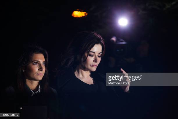 Nigella Lawson leaves Isleworth Crown Court on December 5 2013 in Isleworth England Italian sisters Francesca and Elisabetta Grillo who worked as...