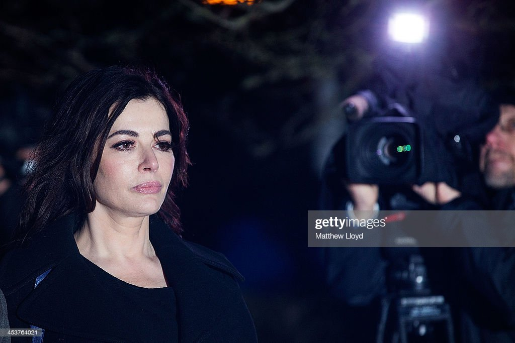 <a gi-track='captionPersonalityLinkClicked' href=/galleries/search?phrase=Nigella+Lawson&family=editorial&specificpeople=209173 ng-click='$event.stopPropagation()'>Nigella Lawson</a> leaves Isleworth Crown Court on December 5, 2013 in Isleworth, England. Italian sisters Francesca and Elisabetta Grillo, who worked as assistants to <a gi-track='captionPersonalityLinkClicked' href=/galleries/search?phrase=Nigella+Lawson&family=editorial&specificpeople=209173 ng-click='$event.stopPropagation()'>Nigella Lawson</a> and Charles Saatchi, are accused of defrauding them of over 300,000 GBP.