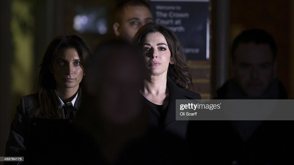<a gi-track='captionPersonalityLinkClicked' href=/galleries/search?phrase=Nigella+Lawson&family=editorial&specificpeople=209173 ng-click='$event.stopPropagation()'>Nigella Lawson</a> (C) leaves Isleworth Crown Court on December 5, 2013 in London, England. Italian sisters Francesca and Elisabetta Grillo, who worked as assistants to <a gi-track='captionPersonalityLinkClicked' href=/galleries/search?phrase=Nigella+Lawson&family=editorial&specificpeople=209173 ng-click='$event.stopPropagation()'>Nigella Lawson</a> and Charles Saatchi, are accused of defrauding them of over 300,000 GBP.