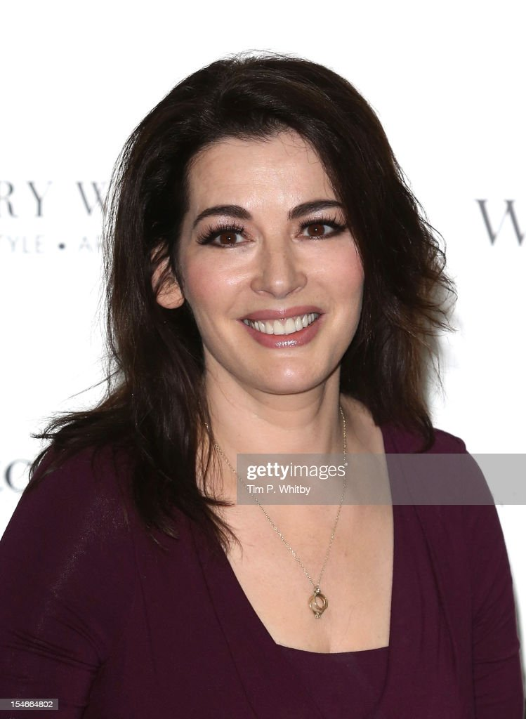 Nigella Lawson meets fans and signs copies of her book 'Nigellissima' at Waterstones Canary Wharf on October 24, 2012 in London, England.