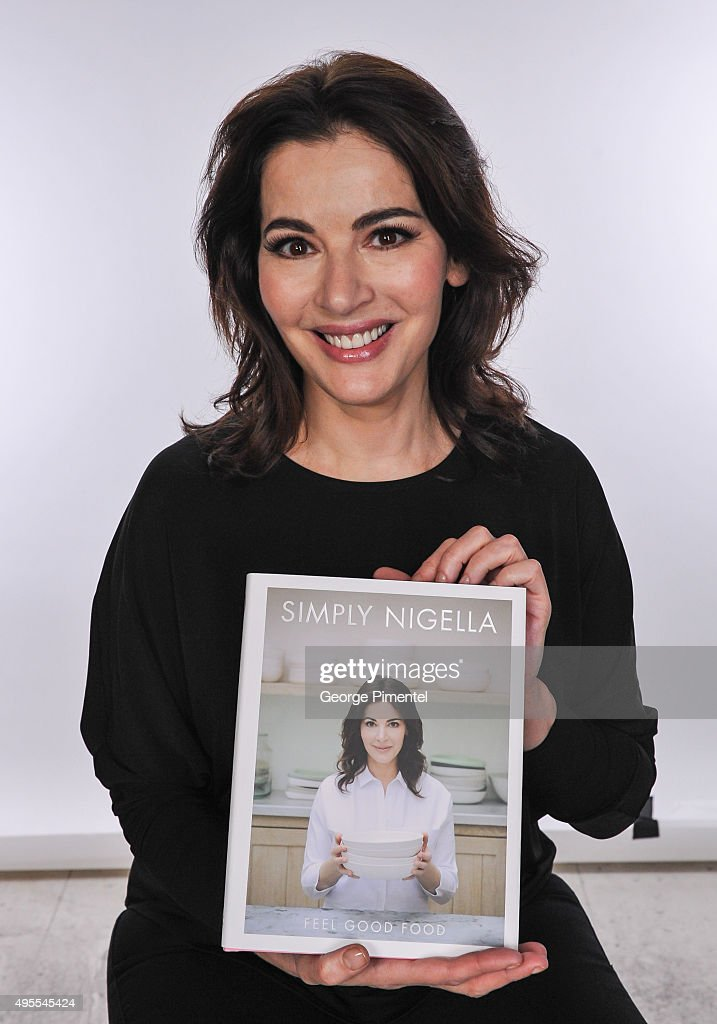 <a gi-track='captionPersonalityLinkClicked' href=/galleries/search?phrase=Nigella+Lawson&family=editorial&specificpeople=209173 ng-click='$event.stopPropagation()'>Nigella Lawson</a> signs copies of her new book 'Simply Nigella' at Indigo Manulife Centre on November 3, 2015 in Toronto, Canada.