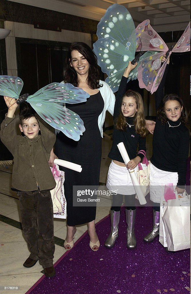 Nigella Lawson with her children arrive for the launch of Madonna's new book 'English Roses', where she read some of her book to over a hundred school children at a tea party at the Rooftop Gardens in Kensington on September 14, 2003 in London.
