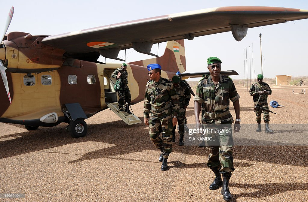 Niger army chief of staff Seyni Garba (2ndR) arrives on February 2, 2013 in Gao to visit Niger's troopsof MISMA mission. French President Francois Hollande received a rapturous welcome as he visited Mali to push for African troops to take over a French-led offensive that drove back Islamist rebels from the country's desert north. AFP PHOTO / SIA KAMBOU