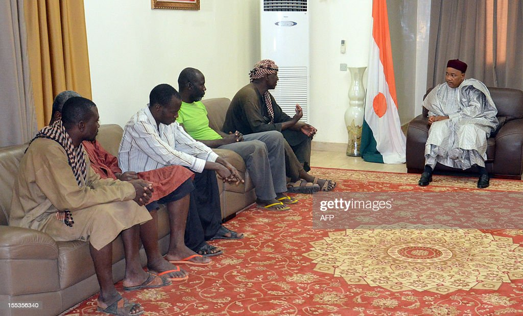Niger President Mahamadou Issoufou (R) meets on November 3, 2012 with four of five African aid workers who were abducted in Niger in mid-October and were recently freed at the presidential palace in Niamey. The five African aid workers were freed alive, while a sixth died after being shot by the Al-Qaeda-linked kidnappers, officials said the workers and their employers said on November 3. One of the hostages said the kidnapping was carried out by the armed Islamist group Movement for Oneness and Jihad in West Africa (MUJAO), one of the Al-Qaeda-backed groups that have seized control of the north in neighbouring Mali.