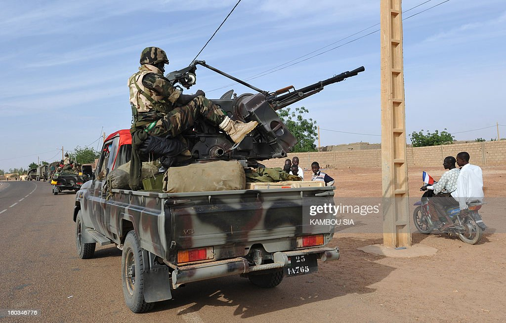Niger troops entered Ansongo, a town south of the northern Malian city of Gao on January 29, 2013. Troops from Niger and Mali on January 29 entered Ansongo, which along with Gao was recaptured by French-led soldiers over the weekend in a lightning offensive against radicals holding Mali's north. So far, just 2,000 African troops have been sent to Mali or neighboring Niger, many of them from Chad, to boost the French-led offensive which began on January 11 and led to the recapture of several towns, including Ansongo. AFP PHOTO / KAMBOU SIA