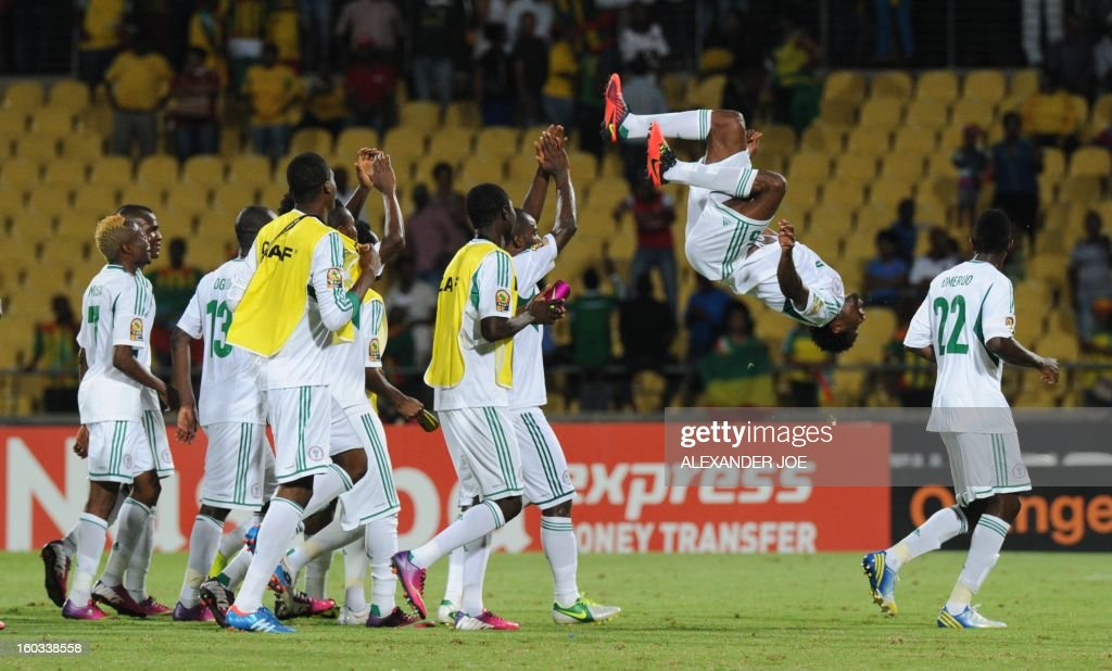 Nigeria defender Efe Ambrose (2nd R) celebrates after his team defeated Ethiopia 2-0 on January 29, 2013 affter a 2013 African Cup of Nations Group C football match at the Royal Bafokeng stadium in Rustenburg.