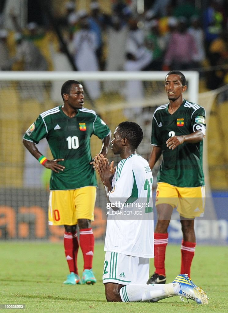 Nigeria defender Juwon Oshaniwa prays on January 29, 2013 after his team defeated Ethiopia 2-0 in a 2013 African Cup of Nations Group C football match at the Royal Bafokeng stadium in Rustenburg.
