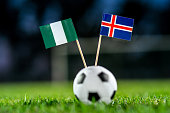 Nigeria - Iceland, Group D, Friday, 22. June, Football, World Cup, Russia 2018, National Flags on green grass, white football ball on ground.