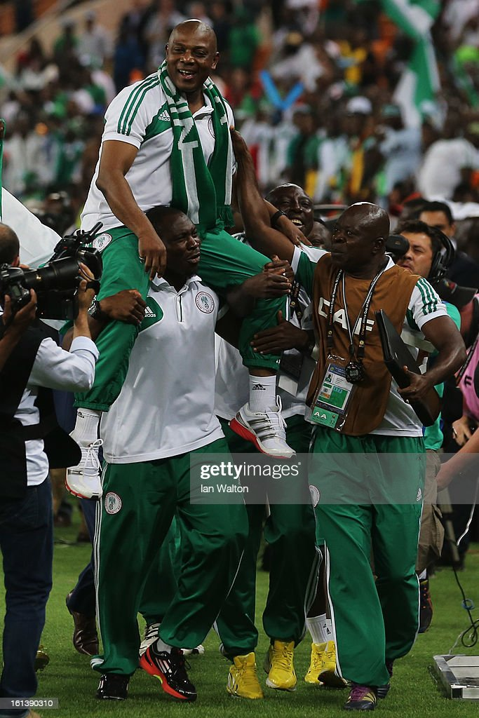 Nigeria Manager, <a gi-track='captionPersonalityLinkClicked' href=/galleries/search?phrase=Stephen+Keshi&family=editorial&specificpeople=774165 ng-click='$event.stopPropagation()'>Stephen Keshi</a> is lifted by his players after winning the 2013 Africa Cup of Nations Final match between Nigeria and Burkina at FNB Stadium on February 10, 2013 in Johannesburg, South Africa.