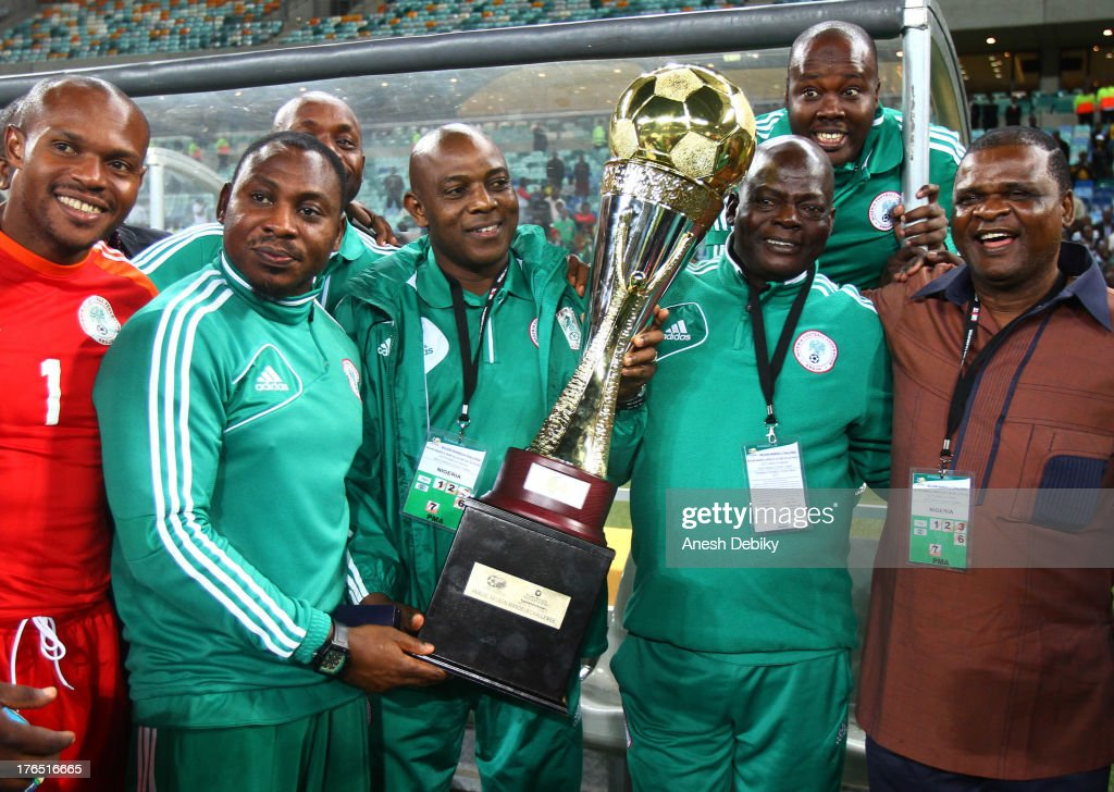 Nigeria manager <a gi-track='captionPersonalityLinkClicked' href=/galleries/search?phrase=Stephen+Keshi&family=editorial&specificpeople=774165 ng-click='$event.stopPropagation()'>Stephen Keshi</a> with the trophy after the 2013 Nelson Mandela Challenge match between South Africa and Nigeria at Moses Mabhida Stadium on August 14, 2013 in Durban, South Africa.