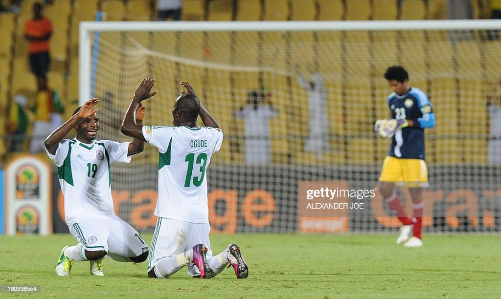 Nigeria midfielder Fegor Ogude (R) and forward Sunday Mba celebrate on January 29, 2013 after their team defeated Ethiopia 2-0 in a 2013 African Cup of Nations Group C football match at the Royal Bafokeng stadium in Rustenburg. AFP PHOTO / ALEXANDER JOE