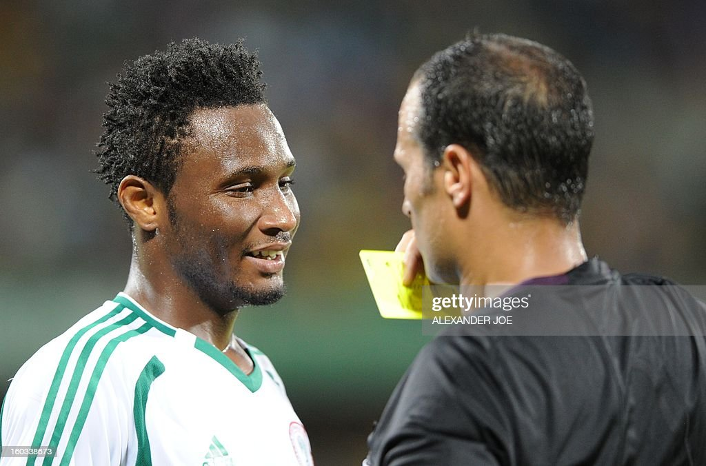 Nigeria midfielder John Obi Mikel (L) gets a yellow card on January 29, 2013 during a 2013 African Cup of Nations Group C football match against Ethiopia at the Royal Bafokeng stadium in Rustenburg.