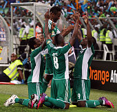 Nigeria players celebrate after the third goal during the 2013 African Cup of Nations SemiFinal match between Mali and Nigeria at Moses Mahbida...