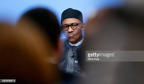 Nigeria President Muhammadu Buhari listens during a panel discussion at the international anticorruption summit on May 12 2016 in London England...