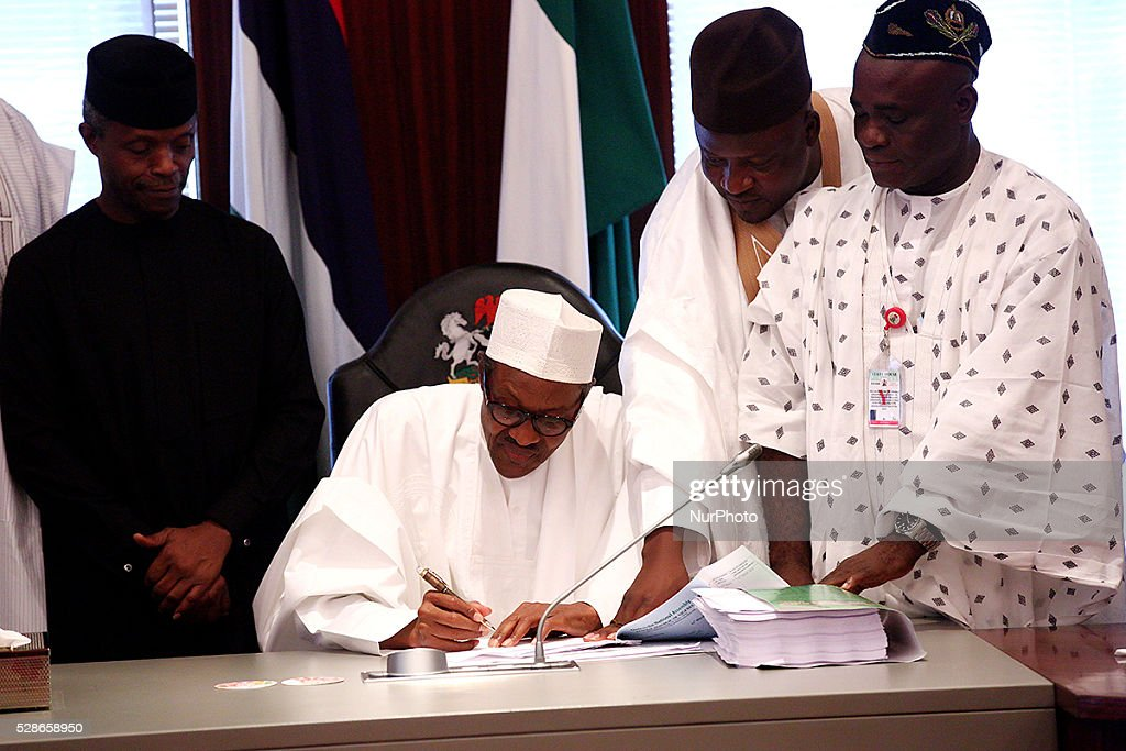 Nigeria President Muhammadu Buhari signs 2016 National Budget into law in the capital, Abuja, Nigeria on May 6, 2016.