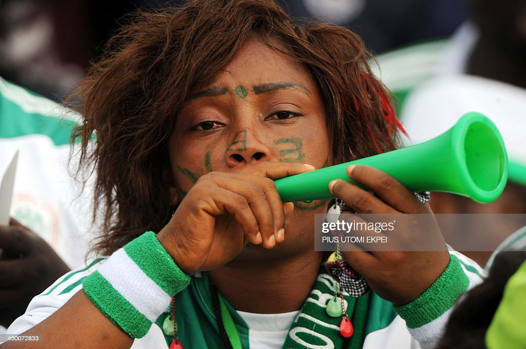 A Nigeria supporter blows a vuvuzela horn during the FIFA 2014 World Cup second leg qualifying football match between Nigeria and Ethiopia in Calabar in November 16, 2013. Nigeria defeated Ethiopia 2-0. AFP PHOTO/PIUS UTOMI EKPEI