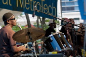 Nigerian AfroBeat musician Tony Allen plays drums as he leads his band during a performance at the BAM Rhythm and Blues Festival concert at Metrotech...