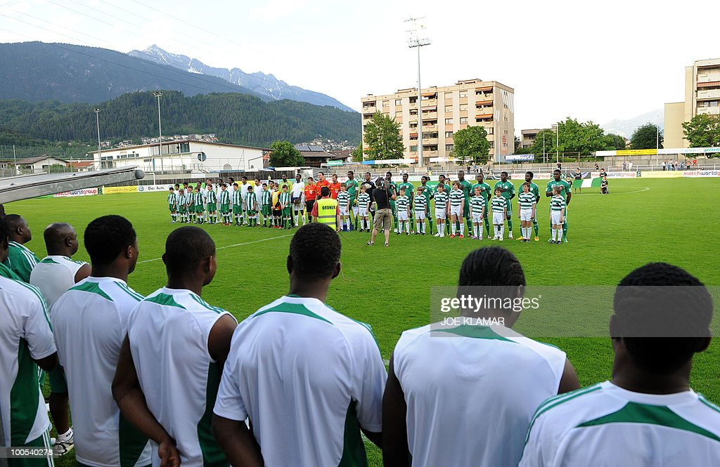 Nigerian and Saudi Arabian teams listen to their national anthems during their friendly match between Saudi Arabia and Nigeria in Alpen stadium in Tyrolian Wattens on 25 May 2010 prior to the FIFA World Cup 2010 hosted by South Africa.i