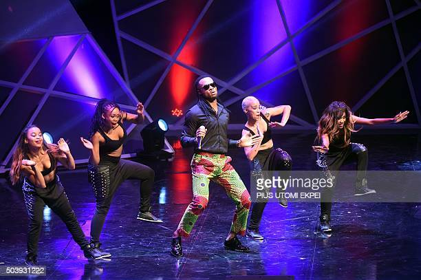 Nigerian artiste Flavour and dancers perform during the African Footballer of the Year Award in Abuja on January 7 2016 Gabonese forward...