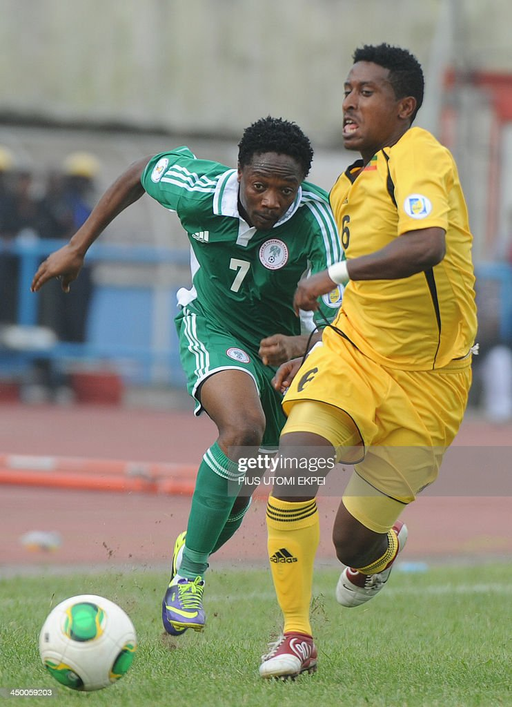 Nigerian attacker Ahmed Musa chases the ball with Ethiopian midfielder Girma Alula during the FIFA World Cup qualifier in Calabar in November 16, 2013. Nigeria defeated Ethiopia 2 - 0 in the second leg to qualify for FIFA 2014 World Cup in Brazil.