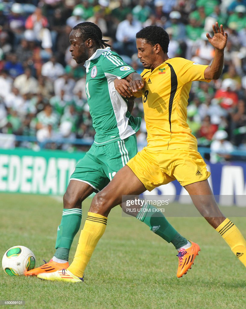 Nigerian attacker Victor Moses vies for ball with Ethiopian midfielder Mekrsa Asrat during the FIFA World Cup qualifier in Calabar in November 16, 2013. Nigeria defeated Ethiopia 2 - 0 in the second leg to qualify for FIFA 2014 World Cup in Brazil. AFP PHOTO/PIUS UTOMI EKPEI