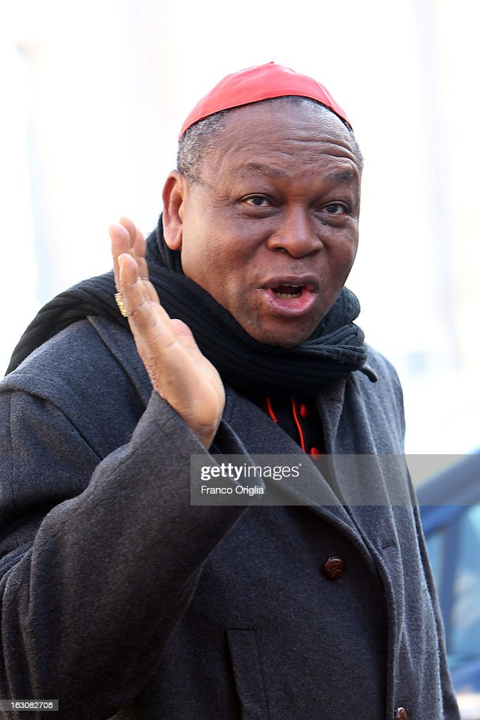 Nigerian cardinal John Olorunfemi Onaiyekan arrives at the Paul VI hall for the opening of the Cardinals' Congregations on March 4, 2013 in Vatican City, Vatican.The congregations of cardinals will continue until all cardinal electors have arrived in Rome, whereupon the College will decide on the start-date of the Conclave to elect a new Pope.
