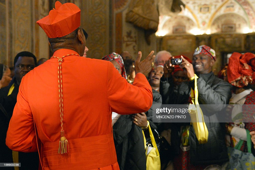 Nigerian cardinal John Onaiyekan (L) greets visitors druing the courtesy visit after being appointed by the pontif on November 24, 2012 at the Apostolico palace at the Vatican. Six non-European prelates are set to join the Catholic Church's College of Cardinals, a move welcomed by critics concerned that the body which will elect the future pope is too Eurocentric.