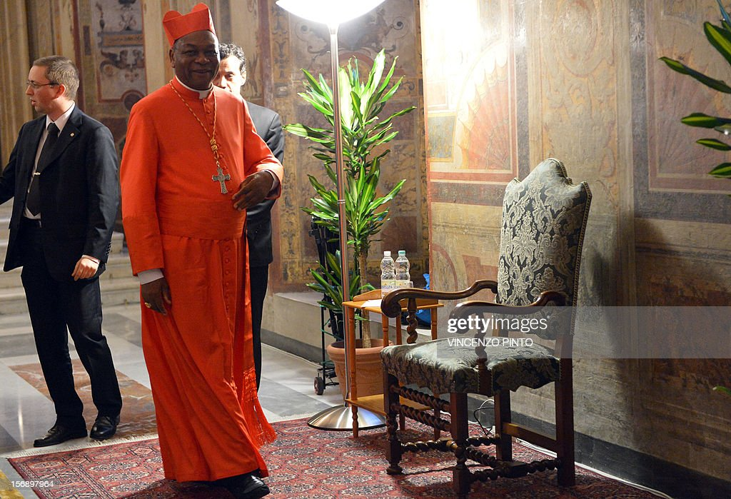 Nigerian cardinal John Onaiyekan takes place for the courtesy visit after being appointed by the pontif on November 24, 2012 at the Apostolico palace at the Vatican. Six non-European prelates are set to join the Catholic Church's College of Cardinals, a move welcomed by critics concerned that the body which will elect the future pope is too Eurocentric. AFP PHOTO / VINCENZO PINTO